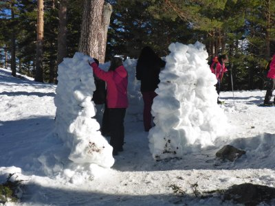 Snowshoes and igloo building children Navacerrada