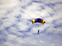 Solo jump with a colorful parachute