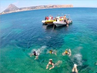 Boat ride around Cabo de San Antonio and snorkel