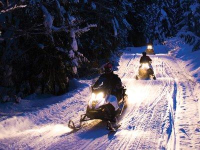 Tandem snowmobile night tour and dinner Encamp
