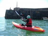 Kayaking out of Mullion Cove