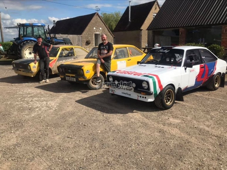 Various rally cars on site