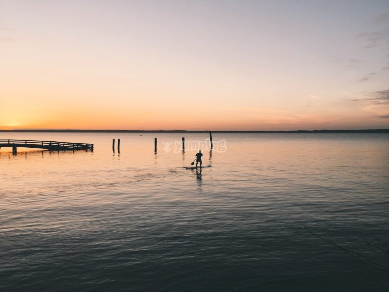 Paddleboarding with a sunset