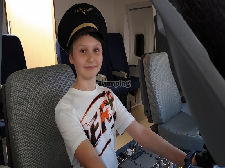 Kid sitting in aircraft