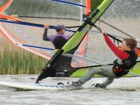 A young windsurfer getting the hang of things