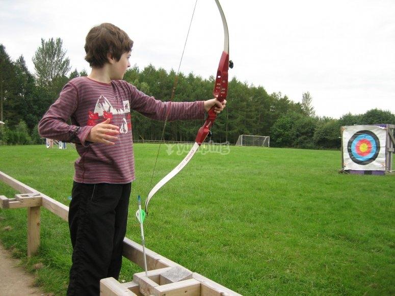 Little Robin Hood shooting an arrow
