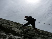 Traditional abseiling from a cliff