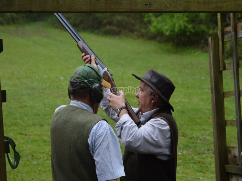 Preparing to try his aiming with the clay pigeon shooting