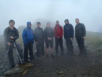 A group stood on top of Ben Nevis, 1 of 3 in the national three peaks