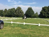 The outdoor arena at Poppyfield Equestrian.