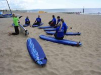 Enjoying one of our surfing lessons