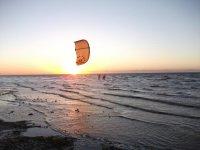 Kitesurfing at sunset