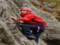 Skillfully scaling the rock