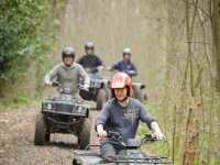 Quad biking through woodland
