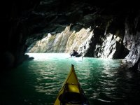 Explore sea caves in Devon.