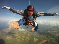 Tandem parachuting with view of the sea