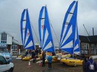 a group of sailboats