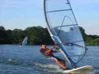 Feel the wind at your back windsurfing