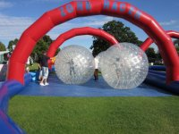 Hire out a zorb course.