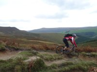 Mountain biking descending to Ladybower