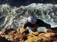 Scrambling up the rocky cliffs