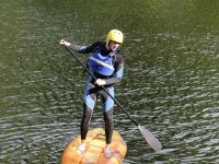 Stand Up Paddle Boarding with Splash White Water Rafting