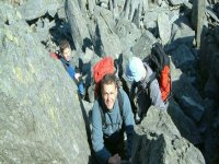Climbing up the challenging bouders
