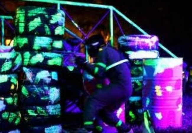 Night paintball with lots of glow in the dark paint